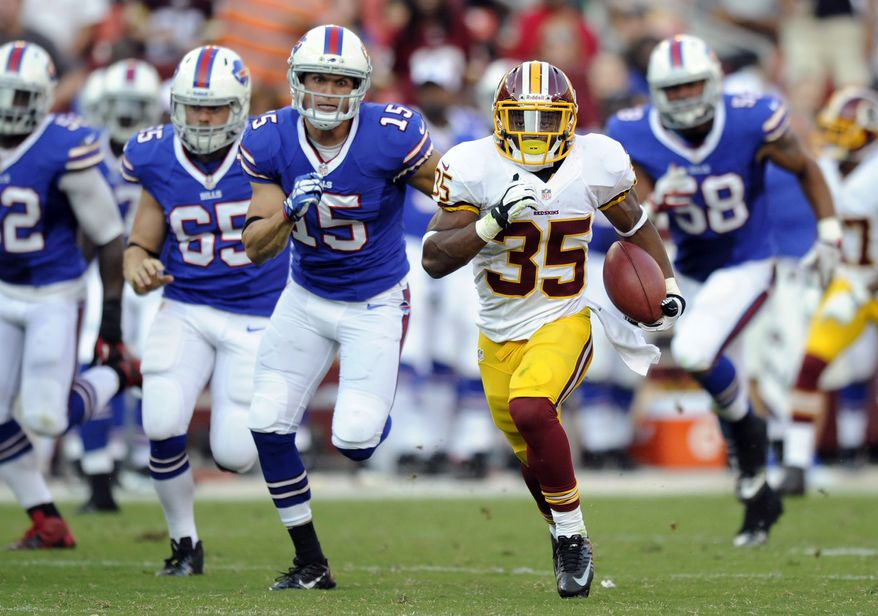 Washington Redskins running back Chris Thompson (35) rushes the ball past Buffalo Bills defenders in the second half of an NFL preseason football game Saturday, Aug. 24, 2013, in Landover, Md. (AP Photo/Nick Wass)