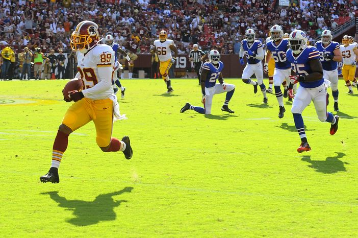 Washington Redskins wide receiver Santana Moss (89) rushes for 45 yards in the first half of an NFL preseason football game against the Buffalo Bills Saturday, Aug. 24, 2013, in Landover, Md. (AP Photo/Richard Lipski)