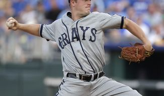 Wearing a Washington Grays Negro Leagues throwback uniform, Washington Nationals starting pitcher Jordan Zimmermann throws during the first inning of a baseball game against the Kansas City Royals Saturday, Aug. 24, 2013, in Kansas City, Mo. (AP Photo/Charlie Riedel)