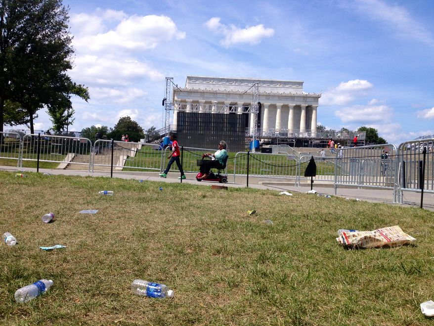 Garbage litters the National Mall in front of the Lincoln Memorial on Sunday, Aug. 25, 2013, a day after the 50th-anniversary commemoration of the March on Washington. (Emily Miller/The Washington Times)