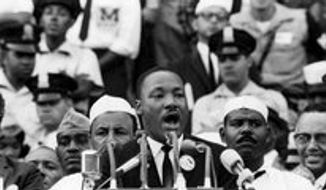 "D.C. police Officer Ken Collins stands behind the left shoulder of Martin Luther King Jr. as King delivers his ""I Have a Dream"" speech Aug. 28, 1963. (associated press)"