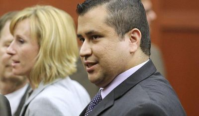 George Zimmerman leaves Seminole Circuit Court with his family on Saturday, July 13, 2013, in Sanford, Fla., after a jury found him not guilty of second-degree murder in the fatal shooting of 17-year-old Trayvon Martin. (AP Photo/Joe Burbank, Pool)