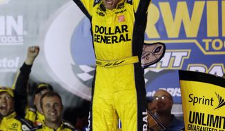 Matt Kenseth celebrates after winning the NASCAR Sprint Cup Series auto race, Saturday, Aug. 24, 2013, at Bristol Motor Speedway in Bristol, Tenn. (AP Photo/Wade Payne)