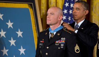 President Obama awards Army Staff Sgt. Ty Carter the Medal of Honor for conspicuous gallantry in a White House ceremony Monday. Sgt. Carter received the medal for his courageous actions Oct. 3, 2009, while serving as a cavalry scout with the 4th Infantry Division in Afghanistan. (Associated Press)