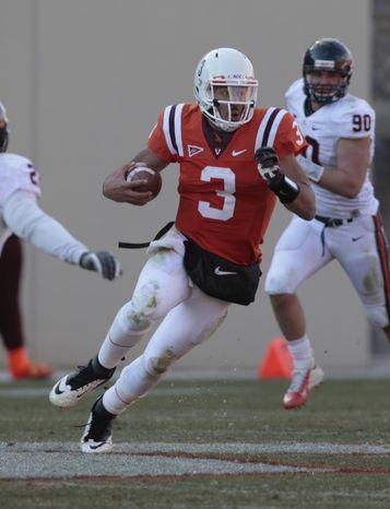 Virginia Tech quarterback Logan Thomas (3) looks for running room during the second half of an NCAA College football game at Lane stadium Saturday, Nov. 24, 2012 in Blacksburg, VA. Tech won the game 17-14. (AP Photo/Steve Helber)