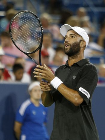 James Blake, from the United States, reacts during a match against Jerzy Janowicz, from Poland, at the Western & Southern Open tennis tournament on Monday, Aug. 12, 2013, in Mason, Ohio. (AP Photo/David Kohl)