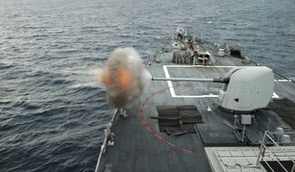 ** FILE ** In this June 6, 2010, file photo, the guided-missile destroyer USS Mahan (DDG 72) fires its MK-45 5-inch/54-caliber lightweight gun during a live-fire weapons exercise in the Atlantic Ocean. Mahan is at sea participating in the Southeast Anti-Submarine Warfare Integration Training Initiative (SEASWITI) exercise 10-3. The multinational exercise is designed to improve their anti-submarine warfare readiness and proficiency. (U.S. Navy photo by Mass Communication Specialist 1st Class Daniel Gay/Released)