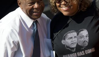 ** FILE ** Rep. John Lewis, D-Ga., left, poses for a photo during an event to commemorate the 50th anniversary of the 1963 March on Washington at the Lincoln Memorial, Saturday, Aug. 24, 2013, in Washington. (AP Photo/Carolyn Kaster)