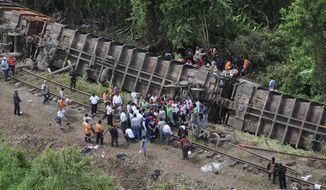 "Rescue workers try to evacuate the injured after a cargo train known as ""the Beast"" derailed near Huimanguillo, Mexico, on Sunday, Aug. 25, 2013. The train, carrying at least 250 Central American hitchhiking migrants, derailed in a remote region, killing at least five people and injuring dozens, authorities said. (AP Photo/Tabasco State Government Press Office)"