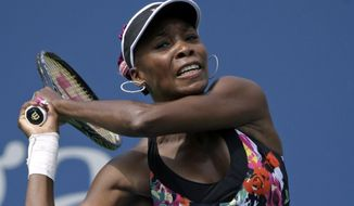 Venus Williams returns a shot to Belgium's Kirsten Flipkens during the first round of the 2013 U.S. Open tennis tournament, Monday, Aug. 26, 2013, in New York. Williams defeated Flipkens. (AP Photo/David Goldman)
