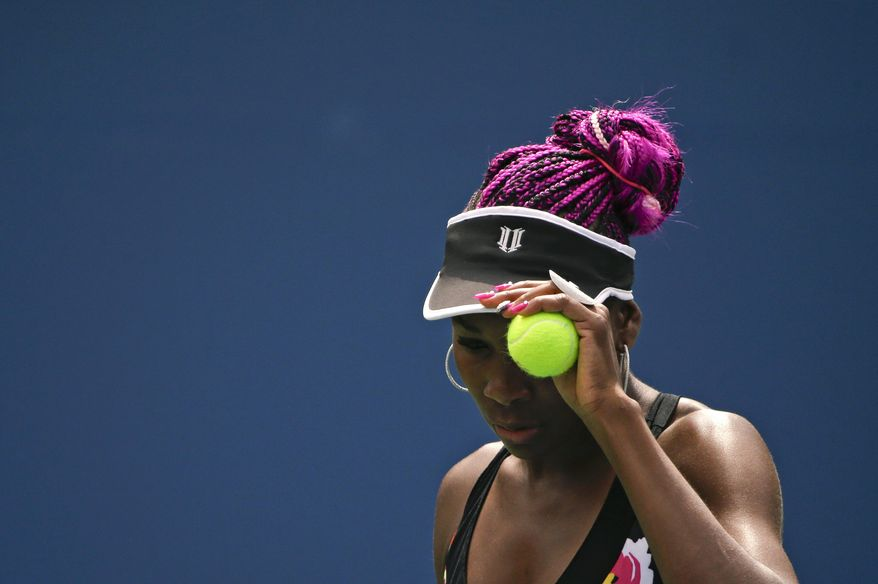 Venus Williams prepares to serve to Belgium's Kirsten Flipkens during the first round of the 2013 U.S. Open tennis tournament Monday, Aug. 26, 2013, in New York. (AP Photo/David Goldman)