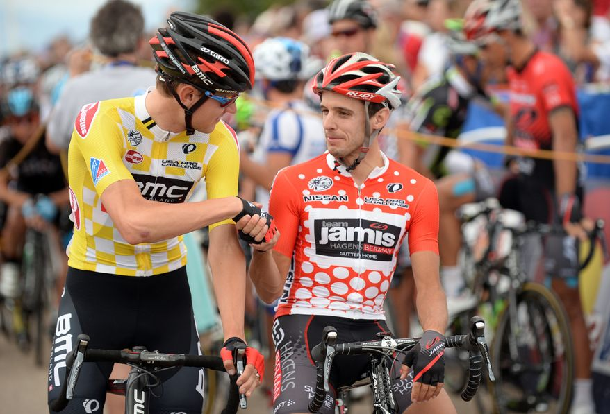 Race leader Tejay van Garderen, left, of BMC Racing Team, shakes hands with Matt Cook, of Jamis-Hagens Berman, at the start line of the sixth stage of the USA Pro Challenge cycling race in Fort Collins, Colo., Saturday, Aug. 24, 2013. (AP Photo/The Denver Post, Hyoung Chang)