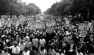 "On Aug. 28, 1963, the Rev. Martin Luther King Jr. and thousands of other civil rights activists marched along Constitution Avenue from the Washington Monument to the Lincoln Memorial, where King delivered his landmark ""I Have a Dream"" speech. (Associated Press Photographs)"
