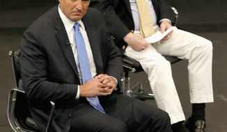 "**FILE** Arizona Republican Sens. John McCain (right) and Jeff Flake listen to a question from the audience as they attend an ""immigration conversation"" on Aug. 27, 2013, in Mesa, Ariz. The two are members of the ""Gang of Eight"" who pushed a comprehensive immigration reform bill through the Senate earlier this year. (Associated Press)"
