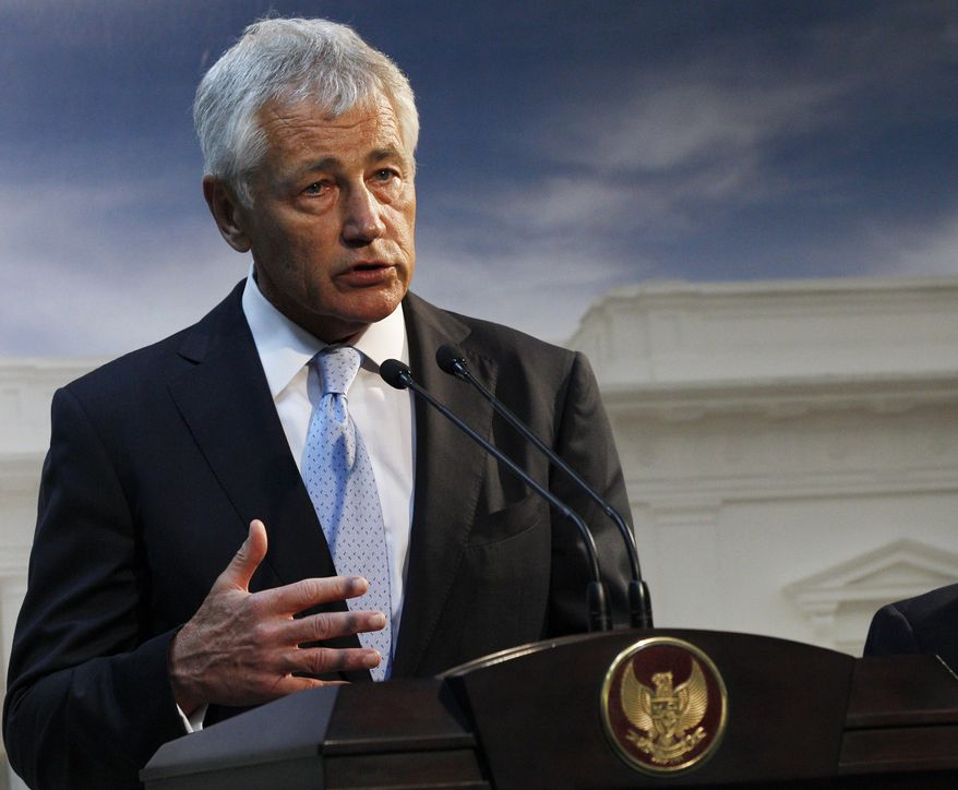 ** FILE ** This Aug. 26, 2013, file photo shows Defense Secretary Chuck Hagel speaking in Jakarta, Indonesia. U.S. forces are now ready to act on any order by President Barack Obama to strike Syria, Hagel said Tuesday. (AP Photo/Achmad Ibrahim, File)