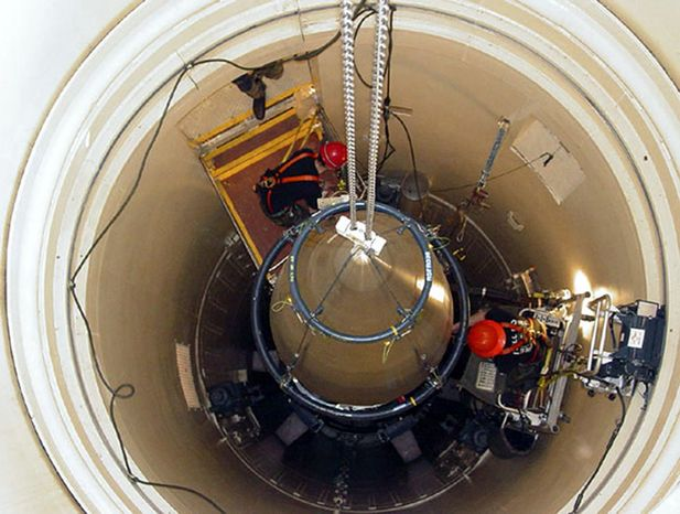 ** FILE ** In this image released by the U.S. Air Force, a Malmstrom Air Force Base missile maintenance team removes the upper section of an ICBM at a Montana missile site. (AP Photo/U.S. Air Force, John Parie)