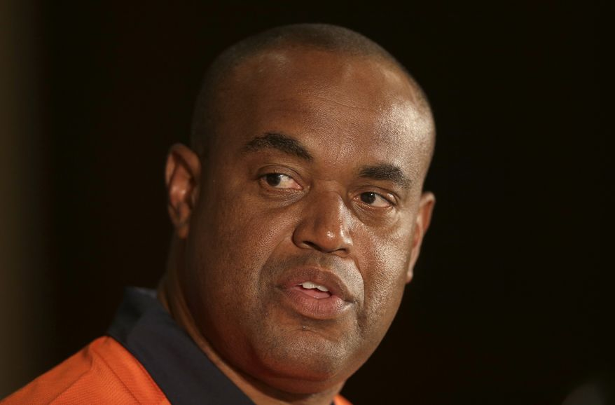 **FILE** Virginia head coach Mike London speaks to the media at a news conference during the Atlantic Coast Conference college football media day in Greensboro, N.C., Monday, July 22, 2013. (AP Photo/Chuck Burton)