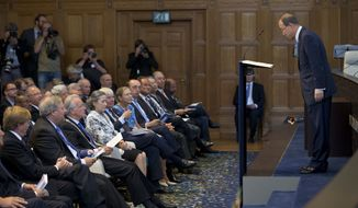 U.N. Secretary General Ban Ki-moon, right, bows to the guests prior to delivering a speech marking the 100th anniversary of the U.N. Peace Palace in The Hague, Netherlands, Wednesday Aug. 28, 2013. (AP Photo/Peter Dejong)
