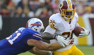 Washington Redskins running back Keiland Williams, right, rushes past Buffalo Bills linebacker Chris White in the second half of an NFL preseason football game Saturday, Aug. 24, 2013, in Landover, Md. (AP Photo/Richard Lipski)