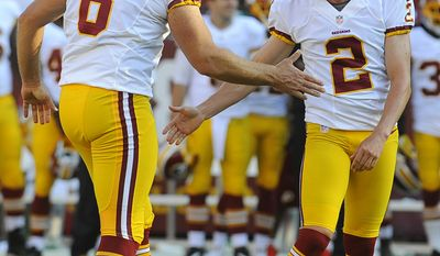 Washington Redskins kicker Kai Forbath (2) high-fives teammate Sav Rocca after making a field goal in the first half of an NFL preseason football game against the Buffalo Bills Saturday, Aug. 24, 2013, in Landover, Md. (AP Photo/Richard Lipski)
