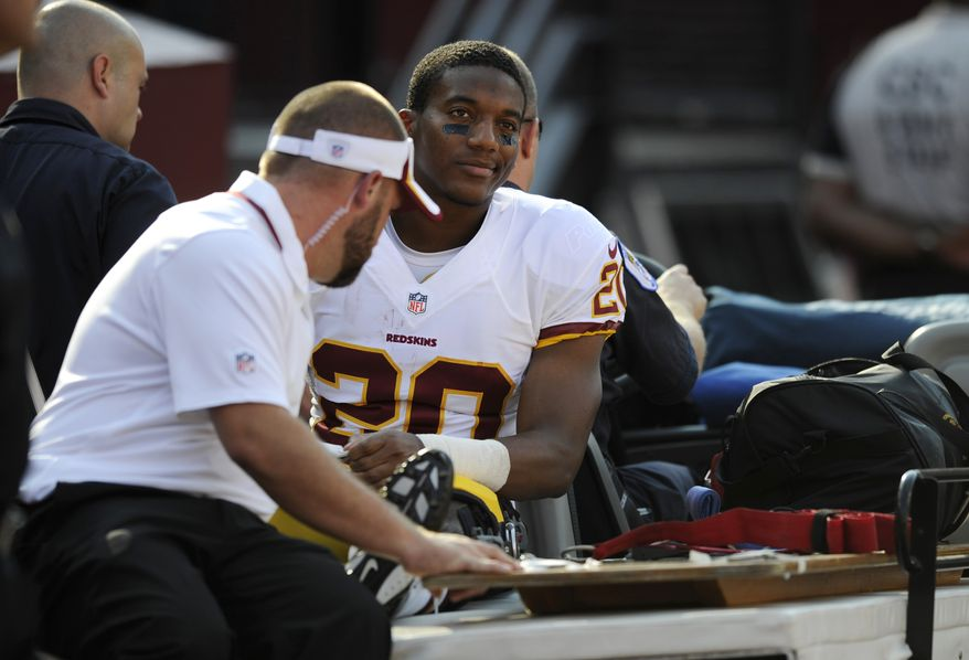 Washington Redskins cornerback Richard Crawford rides a cart off the field in the first half of an NFL preseason football game against the Buffalo Bills Saturday, Aug. 24, 2013, in Landover, Md. (AP Photo/Nick Wass)
