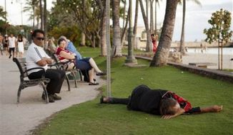 A homeless man sleeps along the beach in Hawaii. (credit: NBC News)