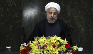 Iranian President Hasan Rouhani speaks during debate on the proposed Cabinet at the parliament in Tehran on Thursday, Aug. 15, 2013. (AP Photo/Ebrahim Noroozi)
