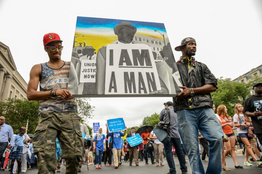 """Jacob Harrison (left) and John Thompson, both of East Orange, N.J., carry a painting made by Thompson as they join thousands in a march down Pennsylvania Avenue to commemorate the 50th anniversary of the March on Washington and Martin Luther King Jr.'s famous """"I Have a Dream"""" speech in D.C. on Aug. 28, 2013. (Andrew Harnik/The Washington Times)"""