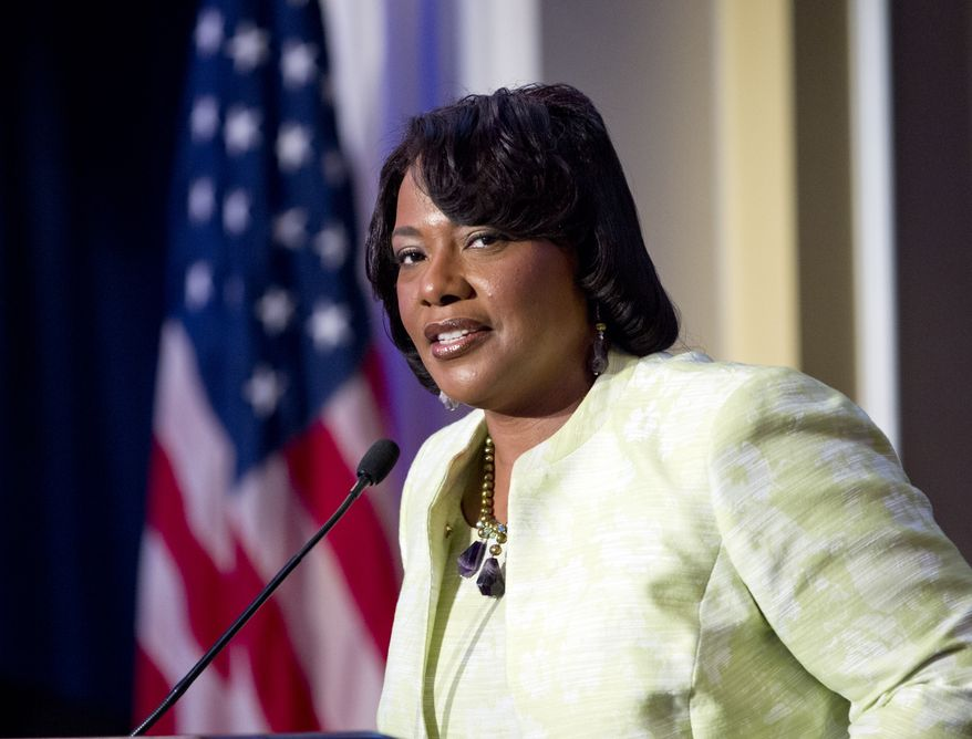 "The Rev. Bernice King, a daughter of the Rev. Martin Luther King Jr., speaks during a ""I Have a Dream"" gospel brunch at the Willard InterContinental in Washington on Sunday, Aug. 25, 2013. (AP Photo/Jose Luis Magana)"