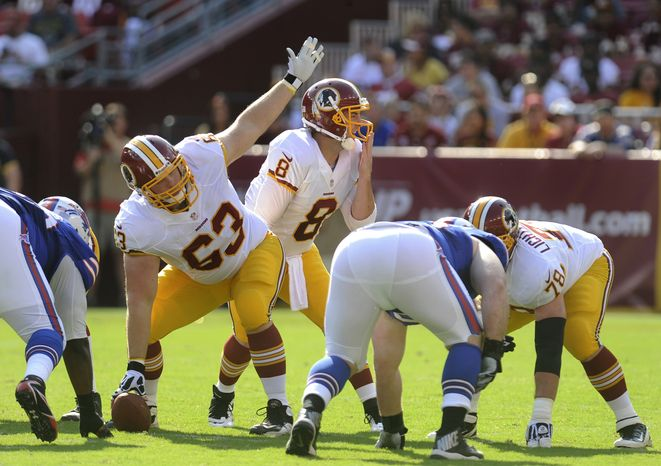 Redskins' quarterback Rex Grossman (8) and his center Will Montgomery (63) signal to their teammates during their NFL preseason football game against the Bills, Saturday, Aug. 24, 2013, in Landover, Md. Redskins defeated the Bills 30-7. (AP Photo/Richard Lipski)