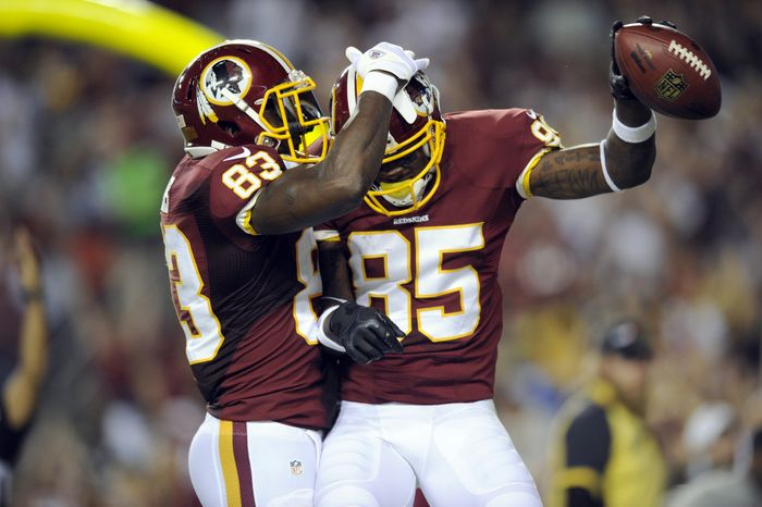 Washington Redskins tight end Fred Davis (83) and wide receiver Leonard Hankerson (85) celebrate Hankerson's touchdown during the first half of an NFL preseason football game against the Pittsburgh Steelers Monday, Aug. 19, 2013, in Landover, Md. (AP Photo/Nick Wass)
