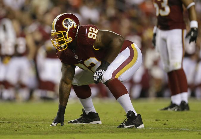 Washington Redskins defensive end Chris Baker prepares for a play during the first half of an NFL preseason football game against the Pittsburgh Steelers Monday, Aug. 19, 2013, in Landover, Md. (AP Photo/Patrick Semansky)