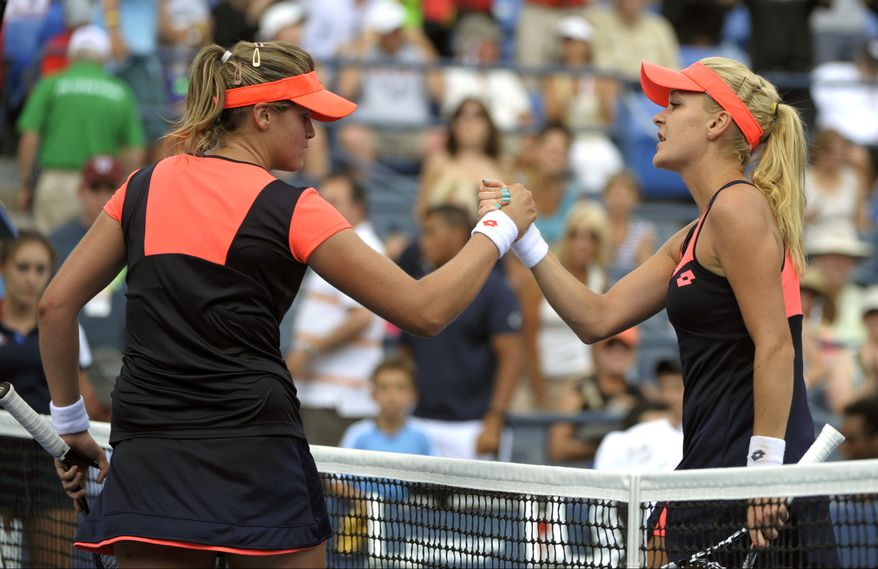Agnieszka Radwanska, of Poland, greets Maria-Teresa Torro-Flor, of Spain, at the net after winning their second-round match at the 2013 U.S. Open tennis tournament, Wednesday, Aug. 28, 2013, in New York. (AP Photo/Kathy Kmonicek)
