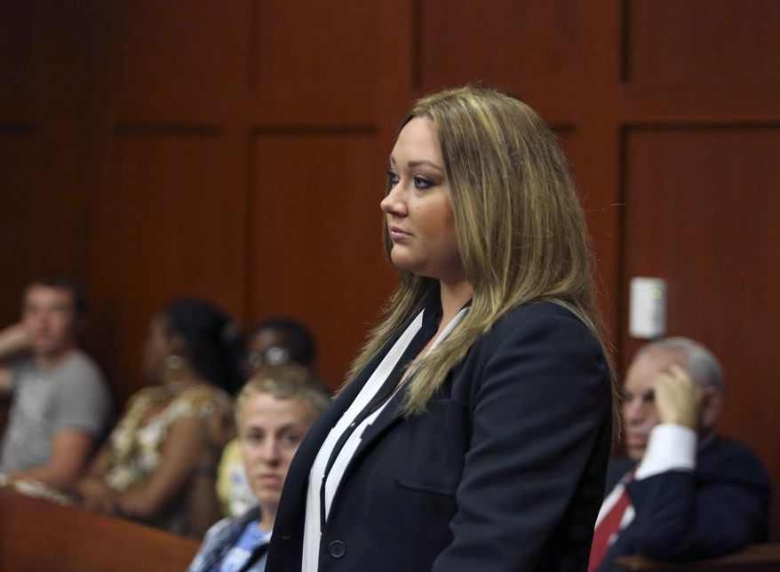 Shellie Zimmerman, wife of George Zimmerman, appears at the Seminole County Courthouse in Sanford, Fla., on Wednesday, Aug. 28, 2013. Shellie Zimmerman pleaded guilty to a misdemeanor perjury charge for lying during a bail hearing after her husband's arrest, and she was sentenced to a year's probation and 100 hours of community service. (AP Photo/Orlando Sentinel, Gary W. Green, Pool)