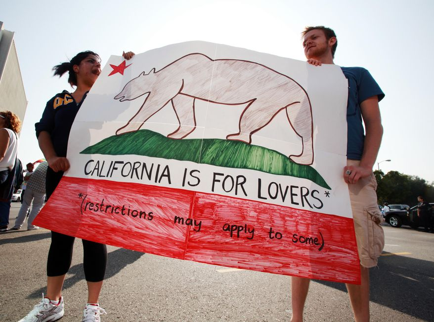 Demonstrators hold a mock California state flag as students and others protest the California Supreme Court's upholding of Proposition 8, which outlawed same-sex marriages, in a march and rally from the UCLA campus to the West Los Angeles Federal Building on May 26, 2009. (Associated Press) **FILE**