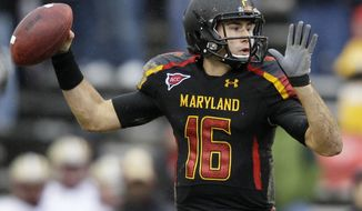 **FILE** Maryland quarterback C..J. Brown throws during the first half of an NCAA college football game against Boston College in College Park, Md., Saturday, Oct. 29, 2011. (AP Photo/Patrick Semansky)