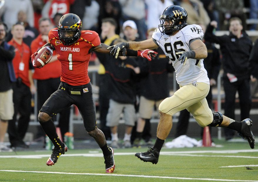 **FILE** Maryland wide receiver Stefon Diggs (1) runs with the ball after a catch for a 63 yard gain against Wake Forest defensive end Hasan Hazime (96) during the second half of an NCAA football game, Saturday, Oct. 6, 2012, in College Park, Md. Maryland won 19-14. (AP Photo/Nick Wass)