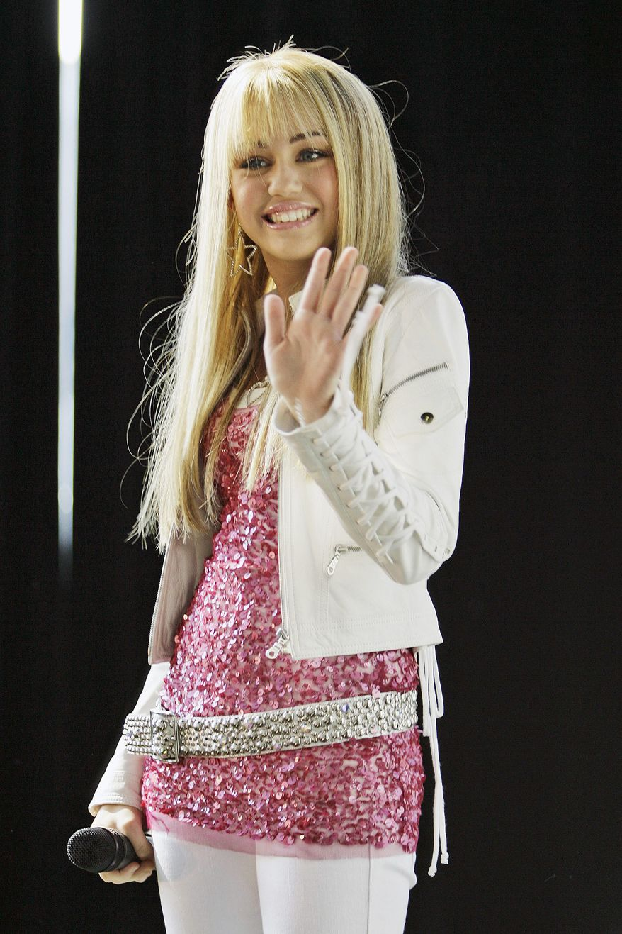 "This June 19, 2007 file photo shows Miley Cyrus, star of The Disney Channel's series ""Hannah Montana,"" as makes an appearance at the Licensing International Expo in New York. Television shows like ""Hannah Montana"" and ""Gossip Girl"" have an effect in tween and teen fashion trends. (AP Photo/Mary Altaffer, FILE)"