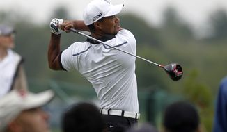 Tiger Woods tees of on the 12th tee during the pro-am round of the Deutsche Bank Championships in Norton, Mass., Thursday, Aug. 29, 2013. (AP Photo/Stew Milne)