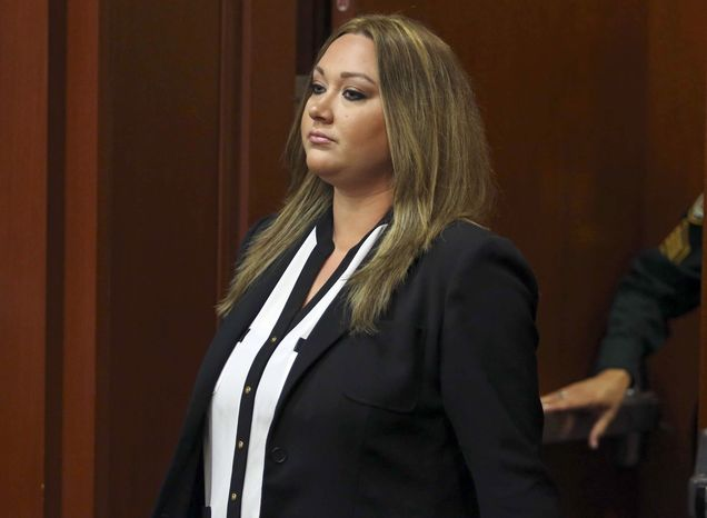 ** FILE ** Shellie Zimmerman pleads guilty at the Seminole County Courthouse in Sanford, Fla. on Aug. 28, 2013, to a misdemeanor perjury charge for lying during a bail hearing after her husband's arrest. She was sentenced to a year's probation and 100 hours of community service. (Associated Press/Orlando Sentinel)