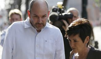 FILE - In this April 9, 2013, file photo, former NFL player Kevin Turner accompanied by Lisa McHale, the widow of former NFL player Tom McHale, walk to the U.S. Courthouse Tuesday, in Philadelphia for a hearing to determine whether the NFL faces years of litigation over concussion-related brain injuries. Judge Anita Brody has announced on Thursday, Aug. 29, 2013 that the NFL and more than 4,500 former players want to settle concussion-related lawsuits for $765 million. (AP Photo/Matt Rourke, File)