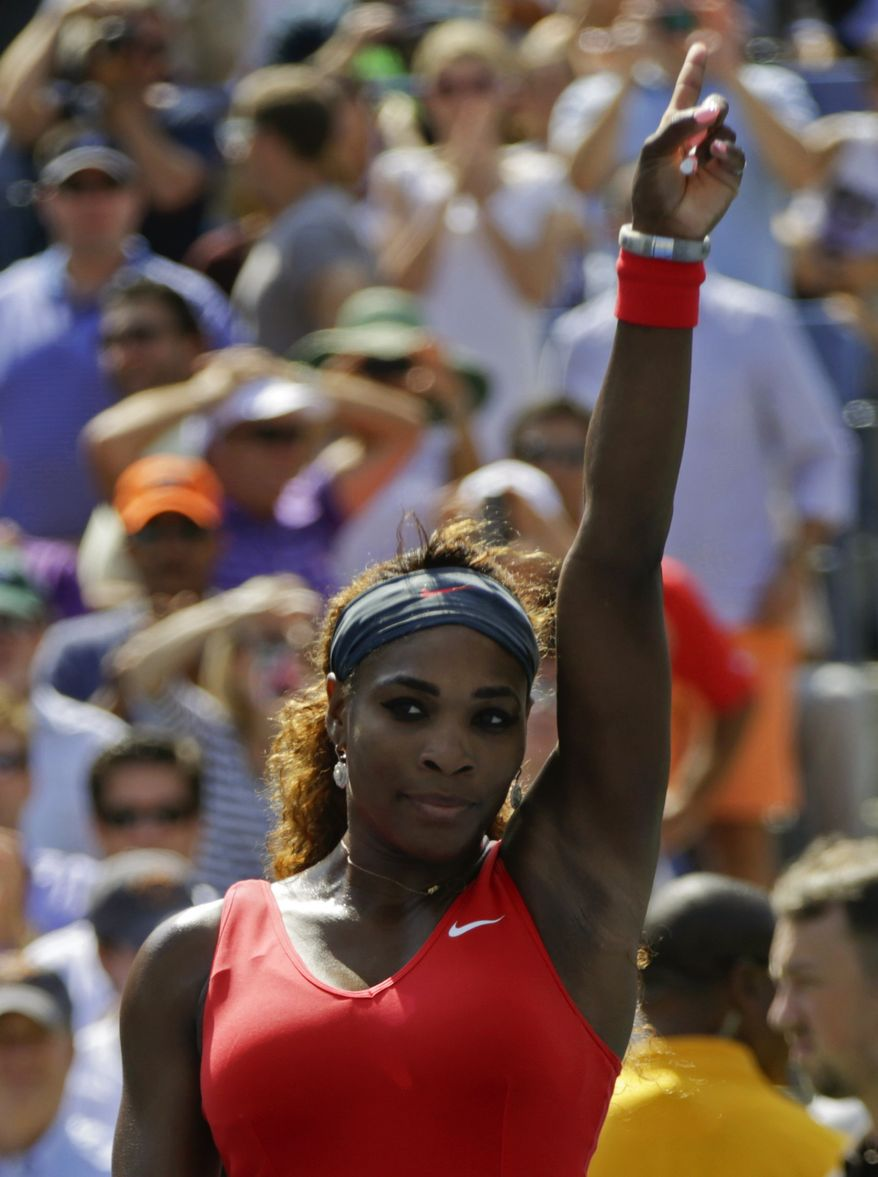 Serena Williams gestures to the crowd after winning her second round match against Galina Voskoboeva, of Kazakhstan, at the 2013 U.S. Open tennis tournament, Thursday, Aug. 29, 2013, in New York. (AP Photo/Kathy Willens)