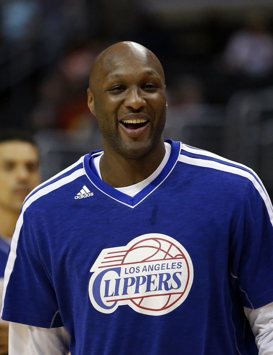 ** FILE ** In this March 13, 2013, file photo, Los Angeles Clippers' Lamar Odom smiles during NBA basketball practice in Los Angeles. Odom was arrested for allegedly driving under the influence early Friday, Aug. 30, 2013, after a CHP officer saw his white Mercedes-Benz traveling erratically on a San Fernando Valley freeway. The CHP says Odom, 33, was arrested after failing a field sobriety test. (AP Photo/Jae C. Hong, File)