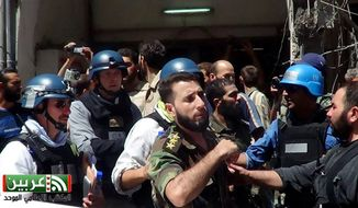 ** FILE ** In this citizen journalism image provided by the United media office of Arbeen which has been authenticated based on its contents and other AP reporting, U.N. investigation team with blue helmets, walk with Syrian rebels in Damascus countryside of Zamalka, Syria, Wednesday, Aug. 28, 2013. (AP Photo/United media office of Arbeen)