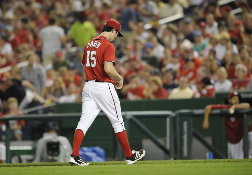 Washington Nationals right-hander Dan Haren walks off the mound in the third inning of the Nationals' 11-3 loss to the New York Mets. (Associated Press photo)