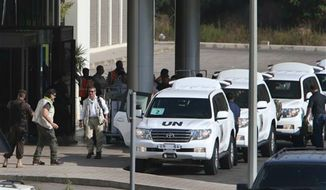 U.N. experts arrive at the entrance of the private jet terminal at Beirut international airport, Lebanon, for the departure, after their convoy of U.N. experts left Syria into Lebanon Saturday, Aug. 31, 2013. (Associated Press)
