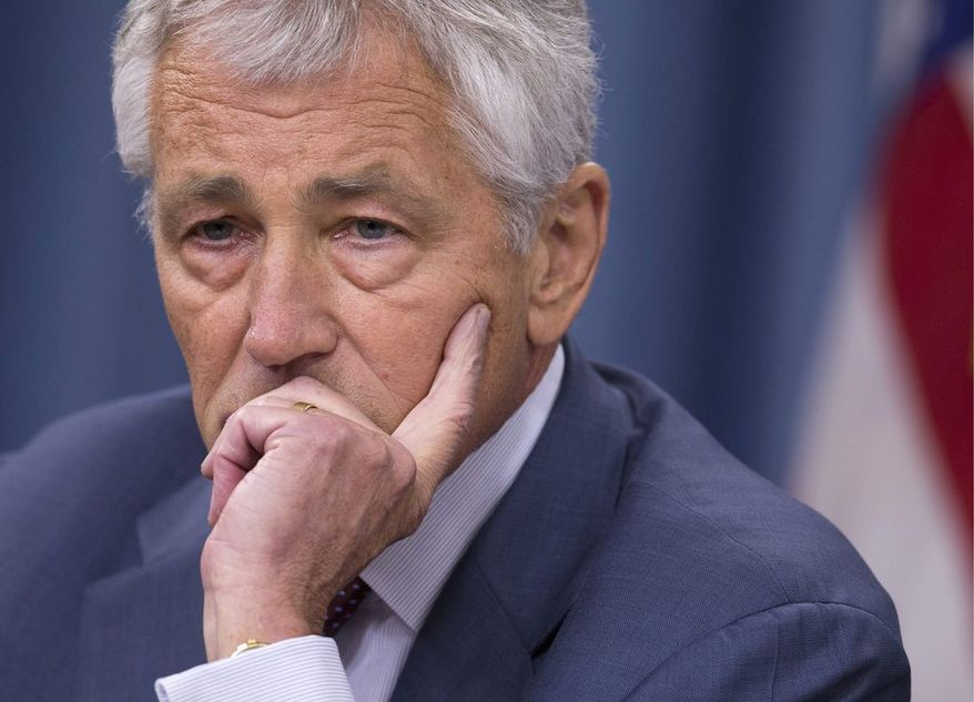 ** FILE ** In this July 31, 2013, file photo, Defense Secretary Chuck Hagel pauses during a news conference at the Pentagon in Washington. Hagel is suggesting Friday, Aug. 23, 2013, that the Pentagon is moving naval forces closer to Syria in case President Barack Obama decides to order military strikes. (AP Photo/Evan Vucci, File)