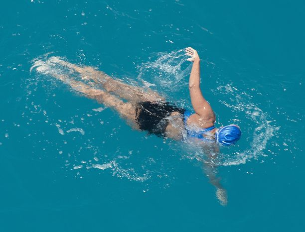In this photo provided by the Florida Keys News Bureau, Diana Nyad, positioned about two miles off Key West, Fla., Monday, Sept. 2, 2013, swims toward the completion of her approximately 110-mile trek from Cuba to the Florida Keys. Nyad, 64, is poised to be the first swimmer to cross the Florida Straits without the security of a shark cage. (AP Photo/Florida Keys News Bureau, Andy Newman)