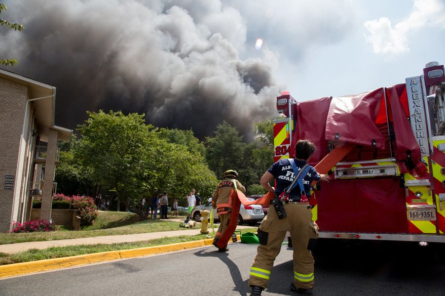 Smoke billows into the sky as fire fighters try to put it out, in Alexandria, VA.,  Monday , September 2, 2013.  (Andrew S Geraci/The Washington Times)