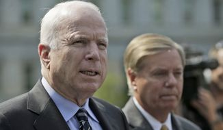Sen. John McCain (left), Arizona Republican, accompanied by Sen. Lindsey Graham, South Carolina Republican, speaks with reporters outside the White House in Washington on Monday, Sept. 2, 2013, following a closed-door meeting with President Obama to discuss the situation in Syria.  (AP Photo/Pablo Martinez Monsivais) ** FILE **